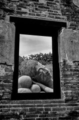 Buddha through window